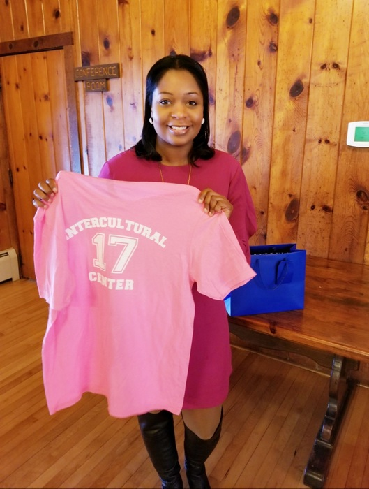 Erin holding Multicultural Center t-shirt from Crowned Rubies at Fredonia State