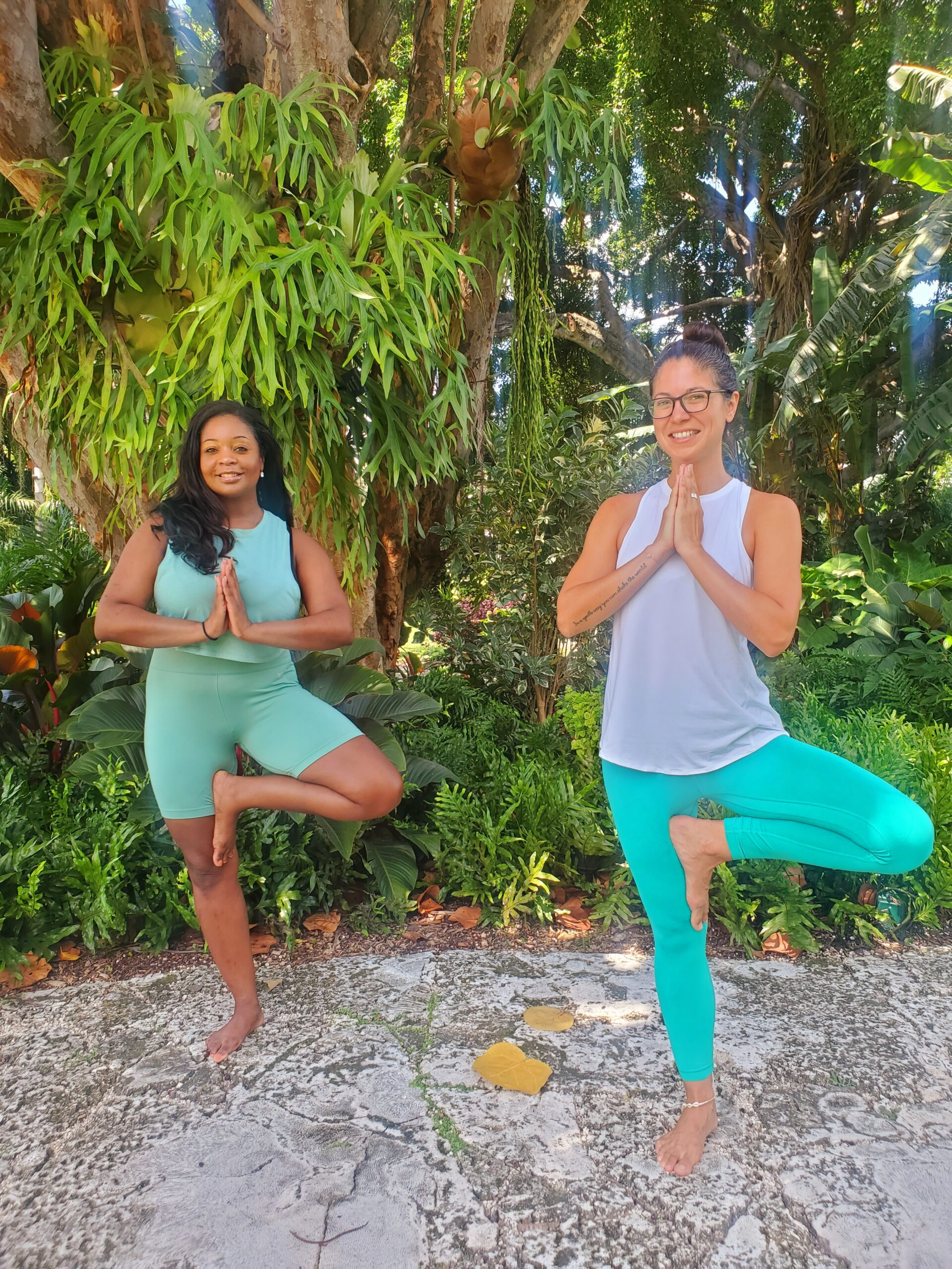 Erin and yoga instructor doing tree pose